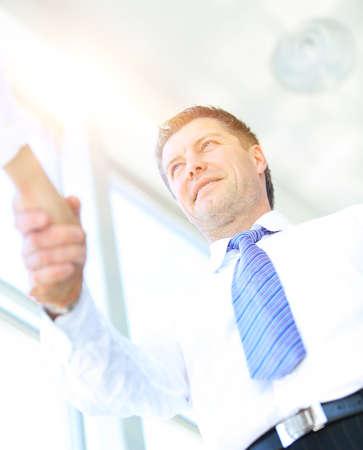 smiling businessman: handshake bottom view. mature businessman smiling Stock Photo
