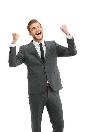 winner man: Lucky handsome businessman celebrating. Winner  laughing man