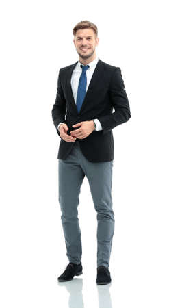 standing businessman: Handsome businessman standing isolated on white background Stock Photo