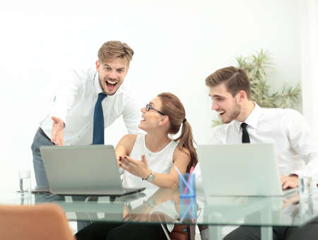 happy worker: Team of three work colleagues with their arms raised in celebration Stock Photo