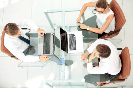 Business team discussing together business plans Stock Photo