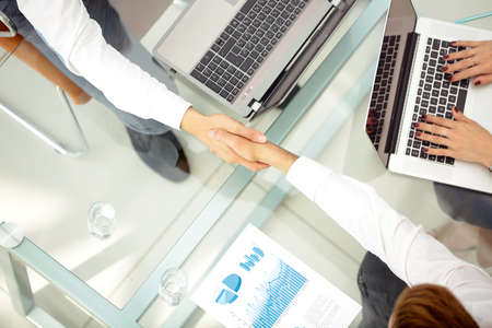 international business agreement: Close up image of a business people making handshake