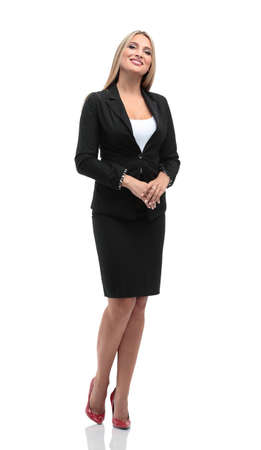 business woman standing: Portrait of young happy smiling businesswoman in suit isolated against white background Stock Photo