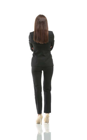 back up: Young businesswoman looking at something. Back view