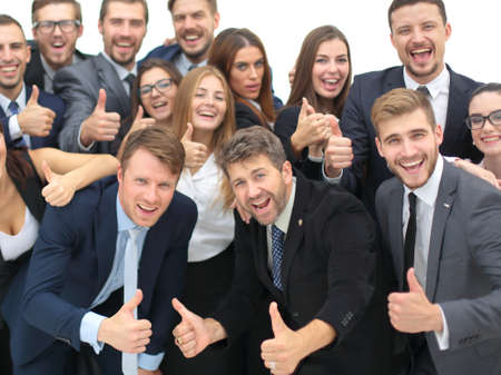Portrait of smiling happy business people against white background celebrating