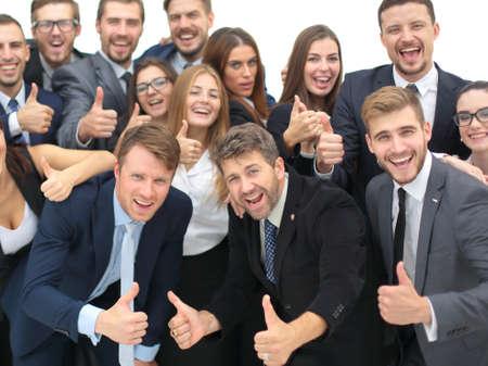 Portret van lachende gelukkige mensen uit het bedrijfsleven tegen de witte achtergrond vieren Stockfoto