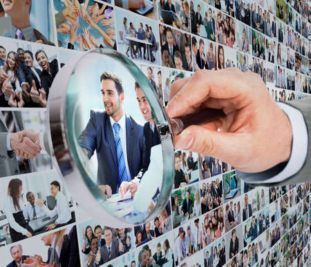 Human resource concept, magnifying glass searching people photo