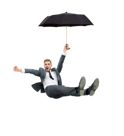 businessman jumping: Image of businessman holding umbrella and flying on a white background Stock Photo