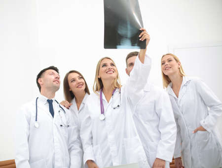 Team Of Medical Professionals Working At The Medical Office. Stock ...