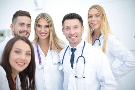 doctors smiling: Smiling Team Of Doctors  At Hospital Making Selfie