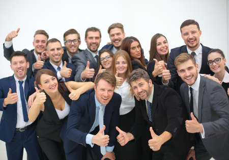 celebra: Group of happy young business people in a meeting at office