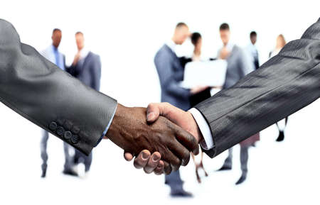 closeup of handshake of business partners on blurred background business team. photo has a empty space for your text