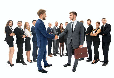 team cooperation: closeup in full growth-business partners shaking hands as a sign of successful cooperation and interest in the background of a successful business team isolated on white background.in the photo there is an empty space for your text
