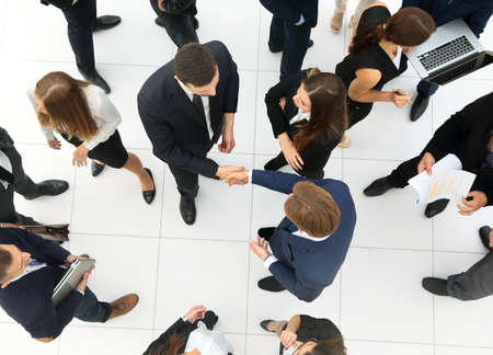Elevated view of large group of multiethnic business people making handshake Stock Photo