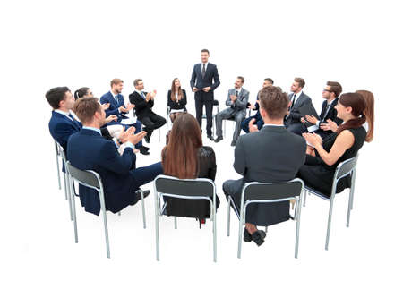 conducts: instructor conducts a seminar on corporate ethics for the business team.business team applauding to speaker.photo on a white background and has an empty space for your text Stock Photo