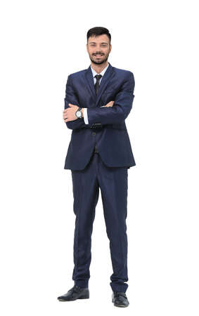 constant: portrait in full growth - is a successful businessman in a stylish black business suit on white background Stock Photo