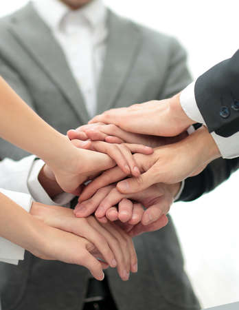 compañerismo: Image of business partners hands on top of each other symbolizing companionship and unity