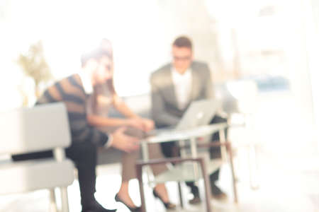 Blurred abstract background of business discussion people group. Blurry view inside office interior