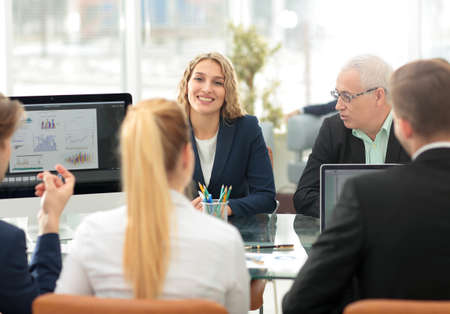 finance report: Young woman accountant stares into the Finance Director who makes a report at the workshop Stock Photo