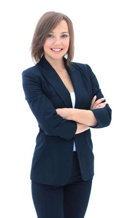 folding arms: Young smiling businesswoman wearing black suit standing and folding arms isolated on white background