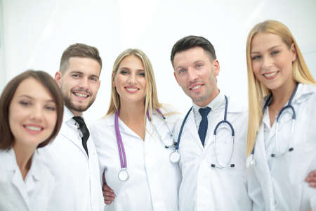 health professional: Cheerful team of doctors and interns make selfie