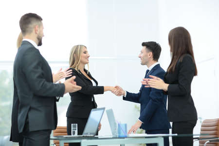 business people meeting: Business people shaking hands, finishing up a meeting Stock Photo