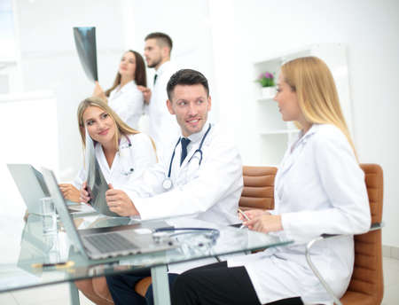 health professional: Portrait of confident happy group of doctors working at the medical office