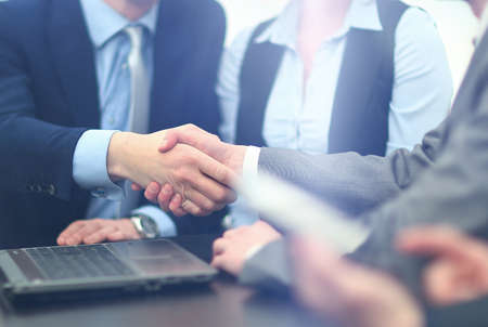 handshaking: business handshake in modern office Stock Photo