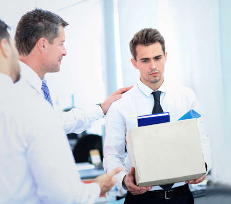 firing: dismissed businessman carrying box Stock Photo