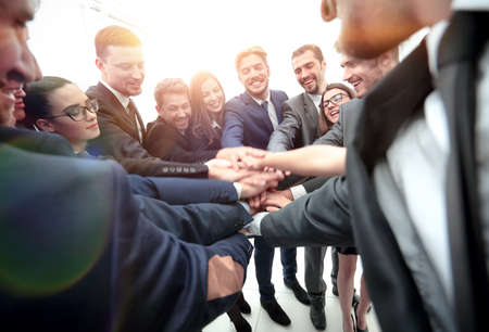 successfull: Large successfull business team showing unity with their hands together