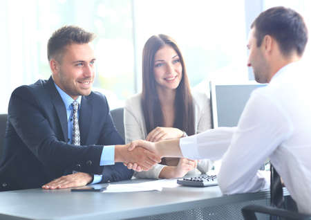 unanimous: Business people shaking hands, finishing up a meeting Stock Photo
