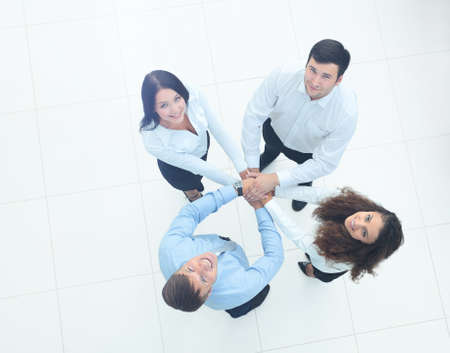 happy workers: Business team showing unity with their hands together Stock Photo