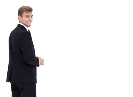 turn back: Smiling business man isolated on white. Side view.