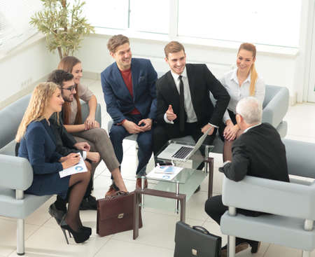 group meeting: Group of business people brainstorming together in the meeting room