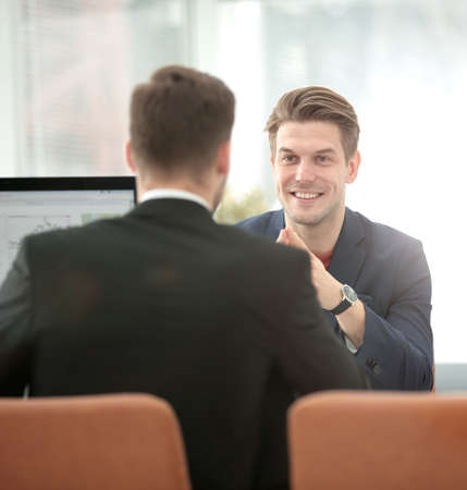 man with laptop: Business team working together to achieve better results