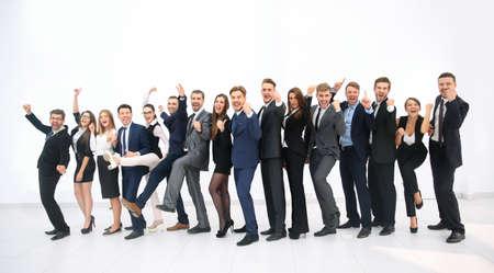 people jumping: Grupo de hombres de negocios de júbilo saltando de alegría y gritando en su entusiasmo en su éxito aislado en blanco Foto de archivo