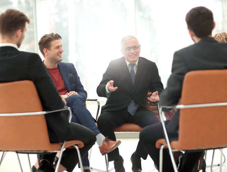 training business: Head of the new business project holds a meeting with his business team. Stock Photo