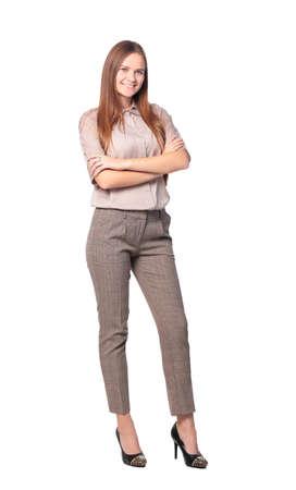 白い背景に分離された交差の腕を持つビジネスの女性の完全な長さ