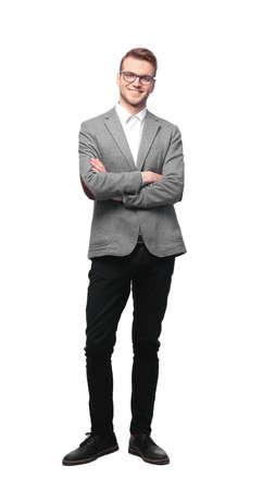 分離の白い背景の上の完全なボディ長さの笑みを浮かべて青年実業家の立っています。 写真素材