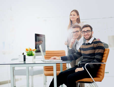 businesspeople: Closeup photo young business managers working with new startup project in office Stock Photo