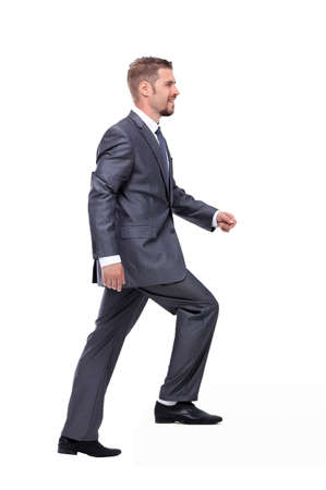 difficult journey: Businessman in suit  following up  over the white background