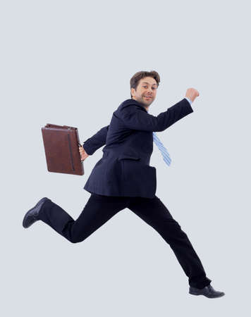 Isolated attractive business man running away from someone