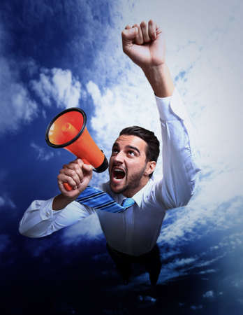 businessman flying and shouting through megaphone