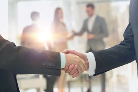 businessman suit: Business handshake of two business man