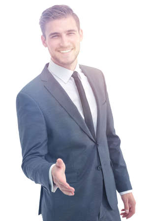 Happy smiling businessman in suit giving hand for handshake. Stock Photo