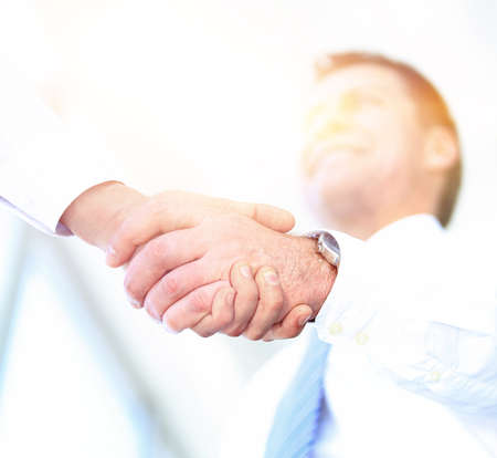 handshake bottom view. mature businessman smiling Stock Photo
