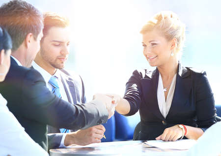 Happy business man and woman shaking hands
