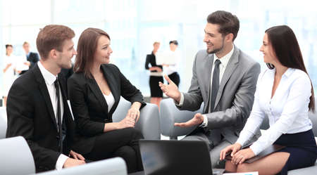 competitive business: Happy business people talking on meeting at office