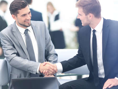 two hands: Business people shaking hands during a meeting