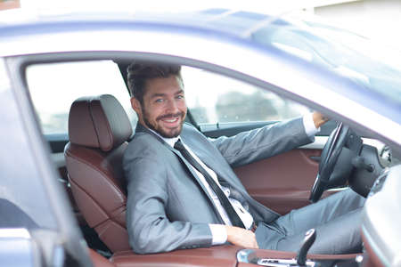 Portrait of a handsome successful business man driving his car Stock Photo